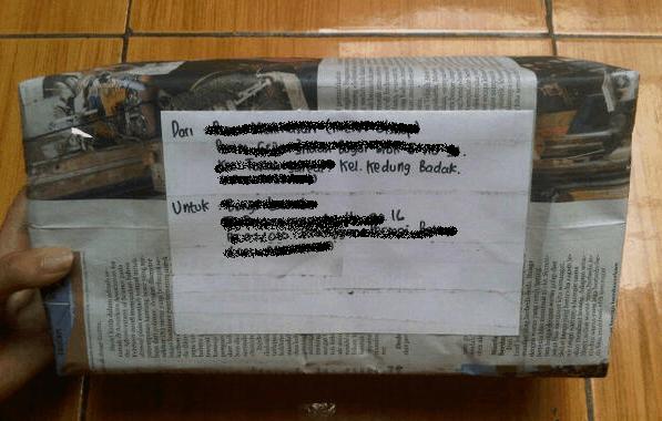 buka paket sebelum konfirmasi